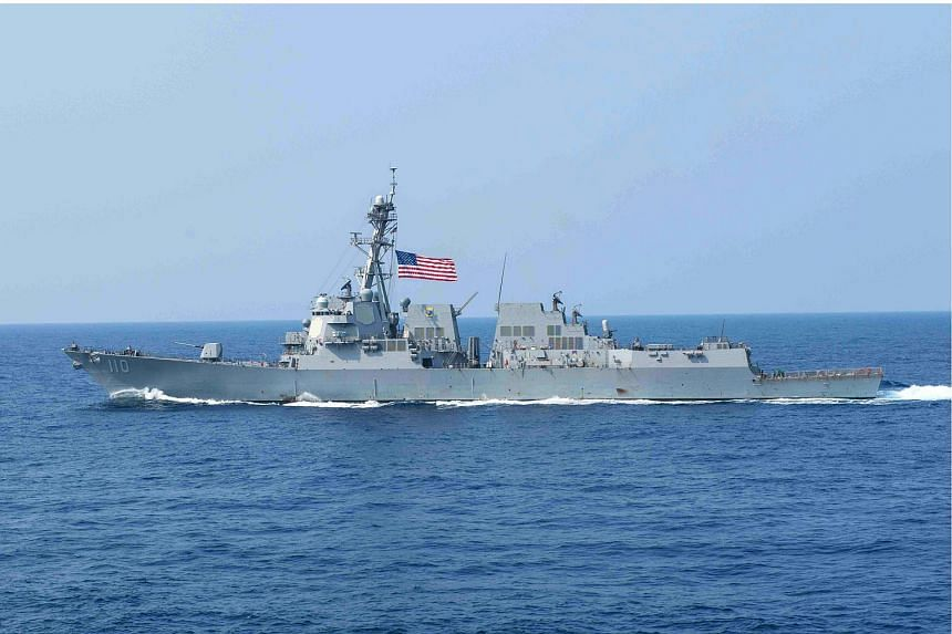 In this March 30, 2016, US Navy handout photo, the guided missile destroyer USS William P. Lawrence (DDG 110) transits the Philippine Sea.