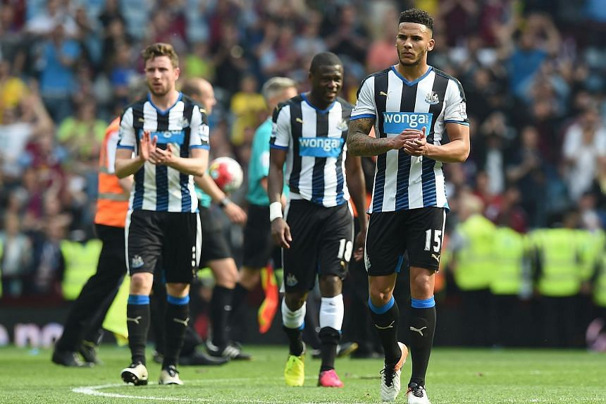 Newcastle United's English defender Jamaal Lascelles (right) reacting on the pitch after the EPL match between Aston Villa and Newcastle United on May 7, 2016.