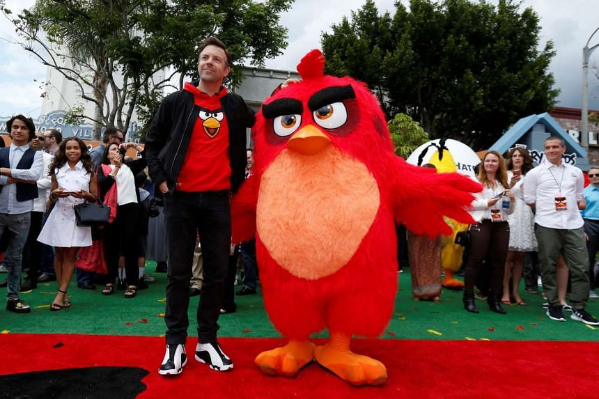 Voice-over cast member Jason Sudeikis poses with the character of Red at the premiere of The Angry Birds Movie in Los Angeles.