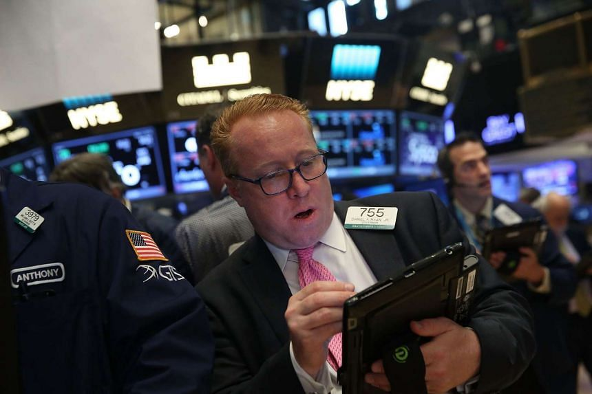 Traders on the floor of the New York Stock Exchange on May 11.