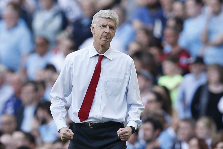 Arsenal manager Arsene Wenger celebrates after the game against Manchester City.