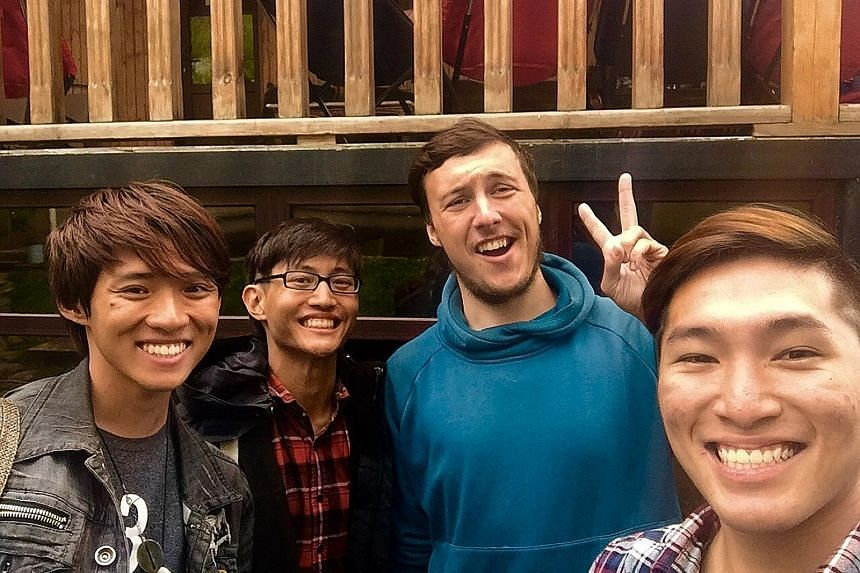 Three for the road: Singaporeans Boh Ze Kai (left), Jeremy Ng (second from left) and Atsushi Yamaguchi (far right) posing with their Russian friend Yuri. They were hiking in the mountains of Svaneti, Georgia.
