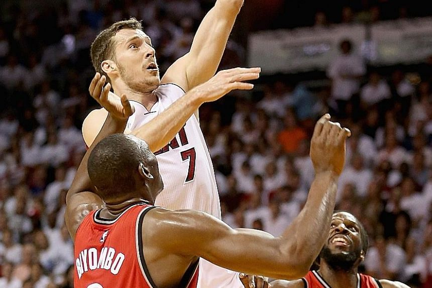 Miami Heat guard Goran Dragic scores two of his 30 points to help his team beat the Toronto Raptors 103-91 and level the Eastern Conference Semi-final series at 3-3.