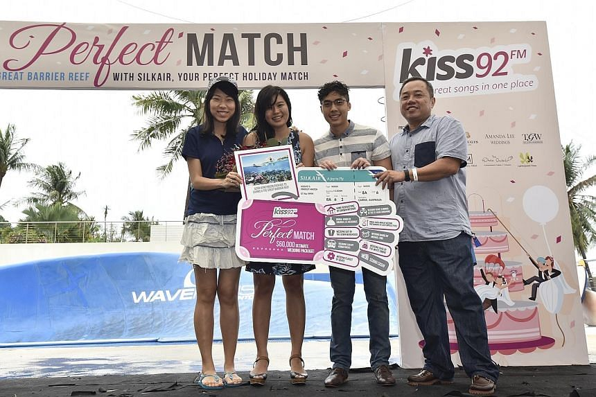 (From left) SilkAir representative Hazel Lee, Kiss92's Perfect Match couple Jae Teo and Janson Leong, and Mr Sim Hong Huat, general manager of SPH Radio at a prize presentation ceremony in Sentosa yesterday. The couple, both 27, beat two other couple