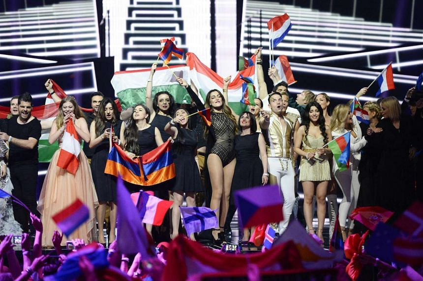 Singers and delegations celebrate on stage after advancing to the grand final, held on May 14, 2016.