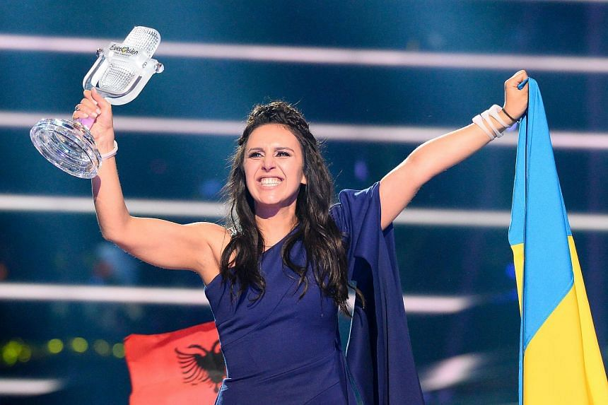 Jamala representing Ukraine with the song 1944 celebrates with the trophy after winning the final of the Eurovision Song Contest 2016.