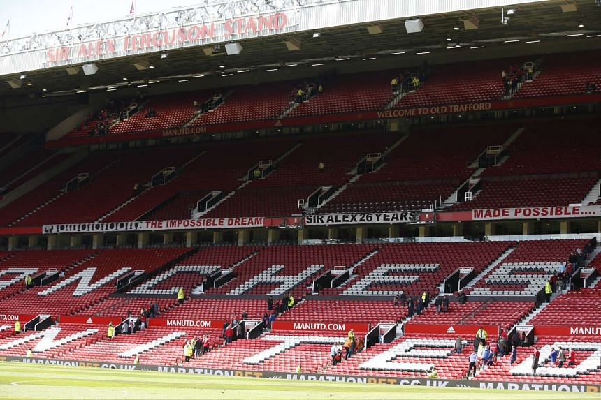 Fans are evacuated from the stadium before the English Premier League soccer match between Manchester United and Bournemouth at Old Trafford in Manchester, Britain, on May 15, 2016.