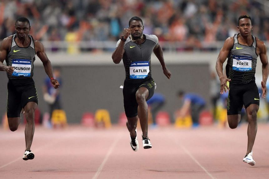Gatlin (centre) competing in the 100m men's race at the Shanghai Diamond League athletics competition.