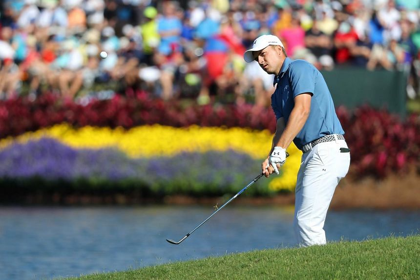 Jordan Spieth chips onto the 16th green during the second round of the Players Championship.