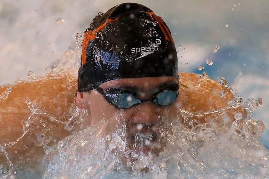 Joseph Schooling competes in the Men's 100 LC Meter Butterfly Finals during day one of the Atlanta Classic Swim Meet.