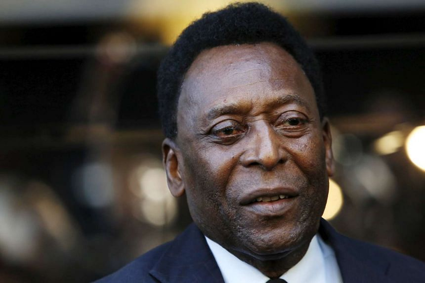 Former soccer player Pele watches on during a ribbon cutting ceremony to celebrate the opening of the flagship Hublot store on Fifth Avenue in New York, on April 19, 2016.