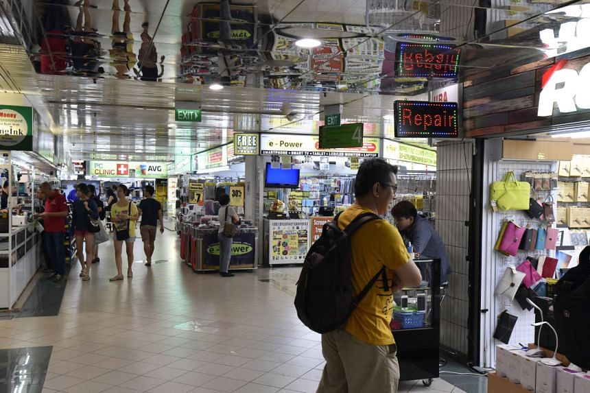 People browsing at level 4 of Sim Lim Square. Proposed changes to the Consumer Protection (Fair Trading) Act may strengthen measures taken against errant retailers who close their shops and secretly reopen them under a different name.