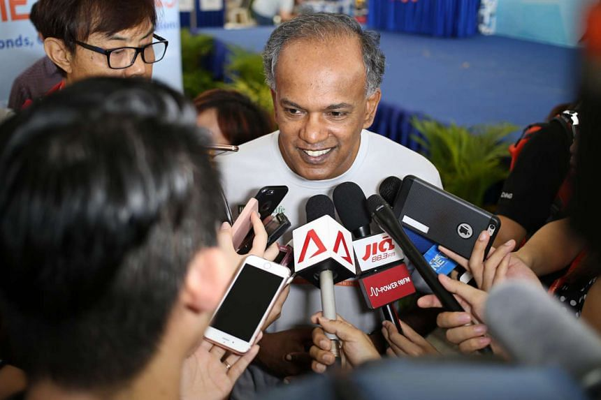 Mr K Shanmugam, Minister for Home Affairs and Minister for Law speaking to reporters at the HomeTeamNS REAL Run held at Sentosa on Sunday (May 15).