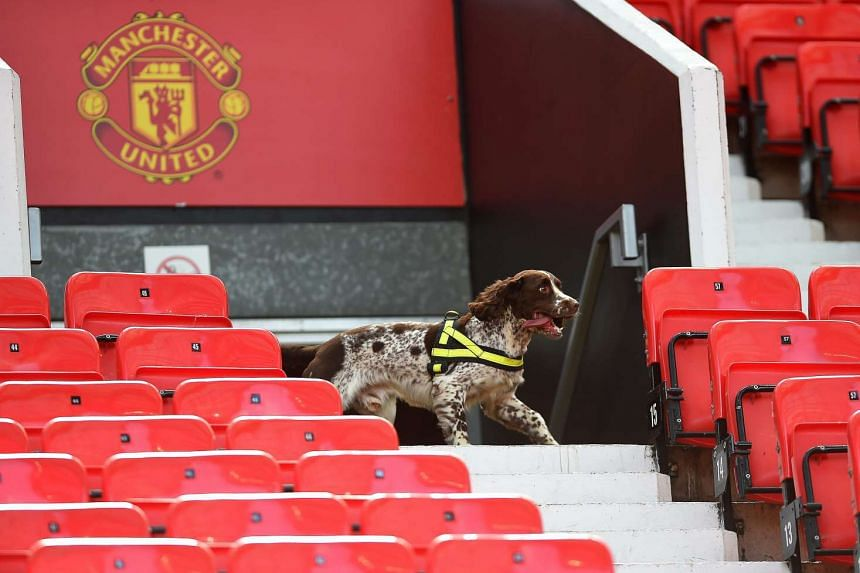 Sniffer dogs search the West Stand after fans are evacuated from the stadium.