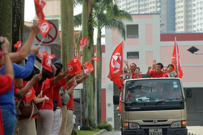 The PAP's Mr Murali and SDP's Dr Chee (above) touring the Bukit Batok estate on May 8, the day after the by-election, to thank residents for their support. Mr Murali won with 61.2 per cent of the votes.