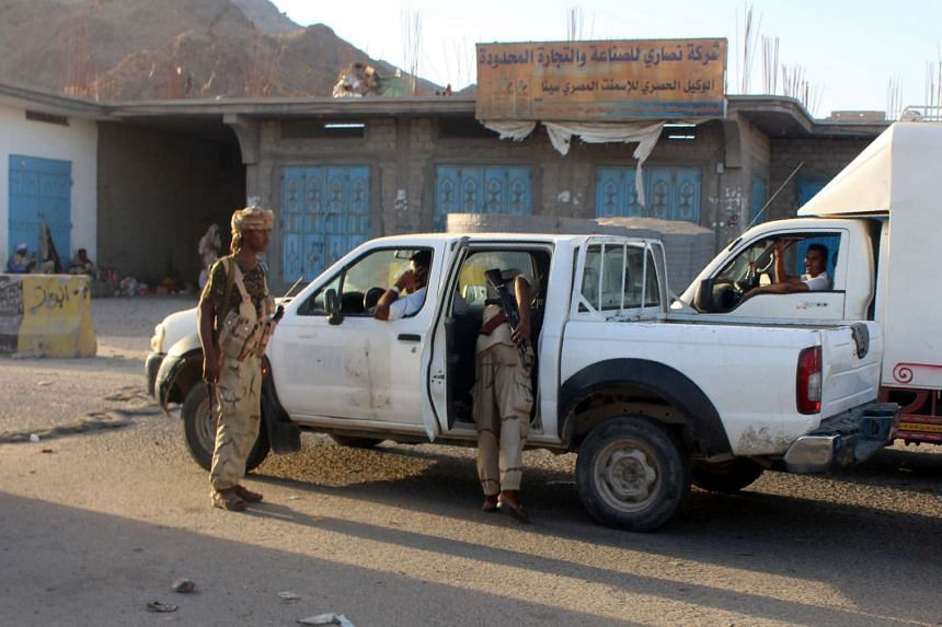 Yemeni troops search a vehicle at a checkpoint following suicide attacks in the southeastern Yemeni port of Mukalla, on May 12, 2016.