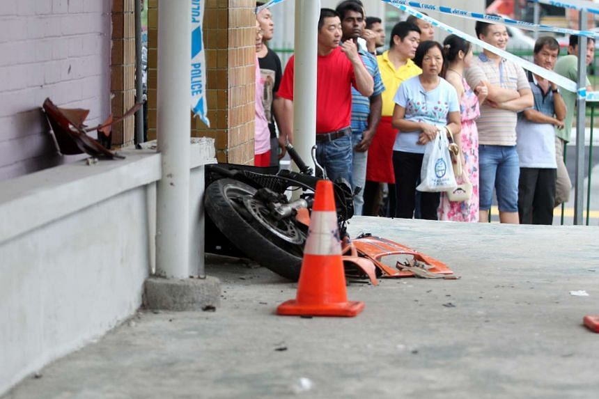 The motorcycle flew over a railing and landed on the pedestrian pathway of Block 209 New Upper Changi Road.
