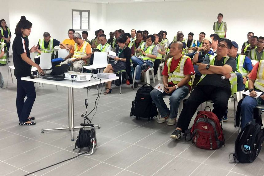 Tower Transit bus drivers attending a disability awareness and sensitivity training session at Bulim Bus Depot on April 27, 2016.