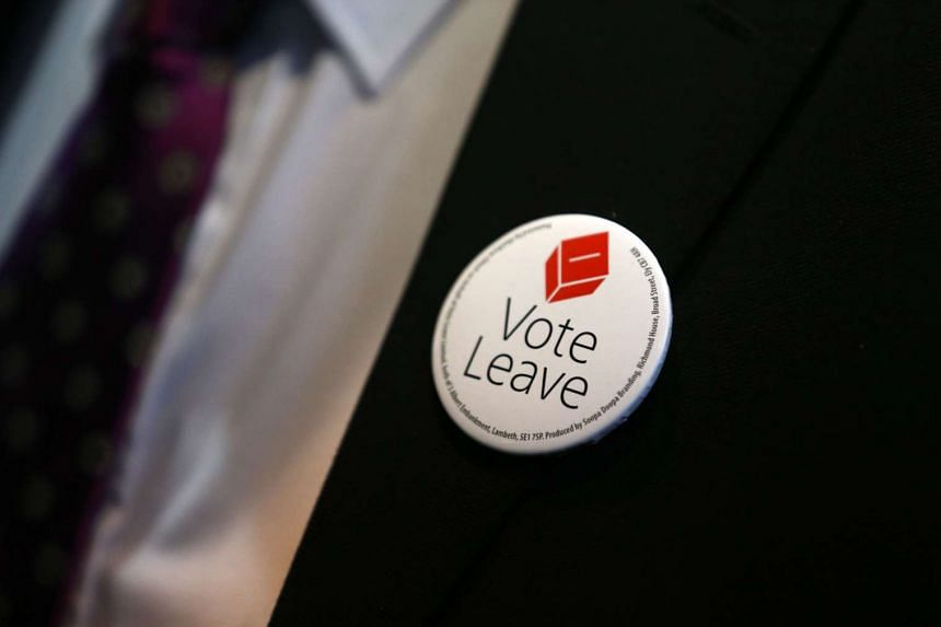 "A ""vote leave"" badge is seen on the jacket of a man as he attends the world premiere of the film Brexit: the Movie in London's Leicester Square, ahead of the EU referendum in Britain."