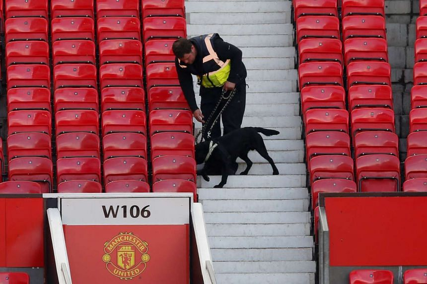 A police dog after the match was abandoned at Old Trafford on May 15, 2016.