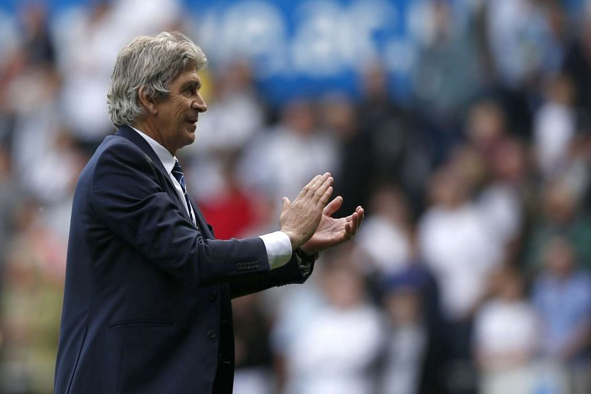 Manchester City manager Manuel Pellegrini applauds fans at the end of his last match in charge at Liberty Stadium on May 15, 2016.
