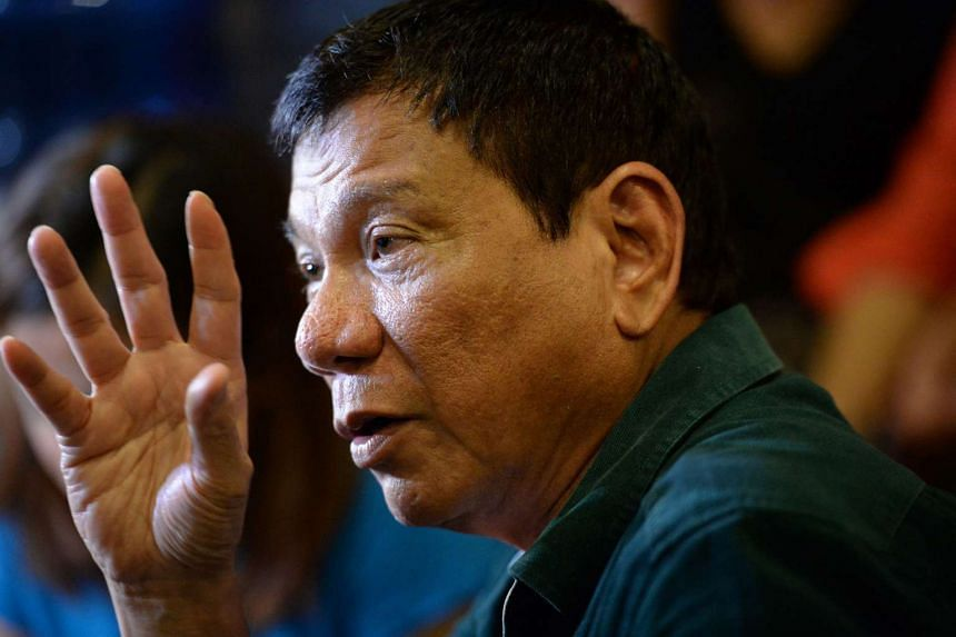 Philippines' President-elect Rodrigo Duterte speaks to the media for the first time after claiming victory in the presidential election, at a restaurant in Davao City, on the southern island of Mindanao on May 15, 2016.