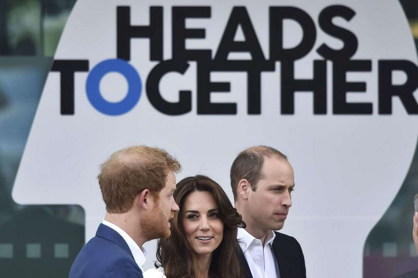 Britain's Prince William, The Duke of Cambridge (right) his wife Catherine, the Duchess of Cambridge and Prince Harry arrive at the launch of their Heads Together campaignin London, on May 16, 2016.