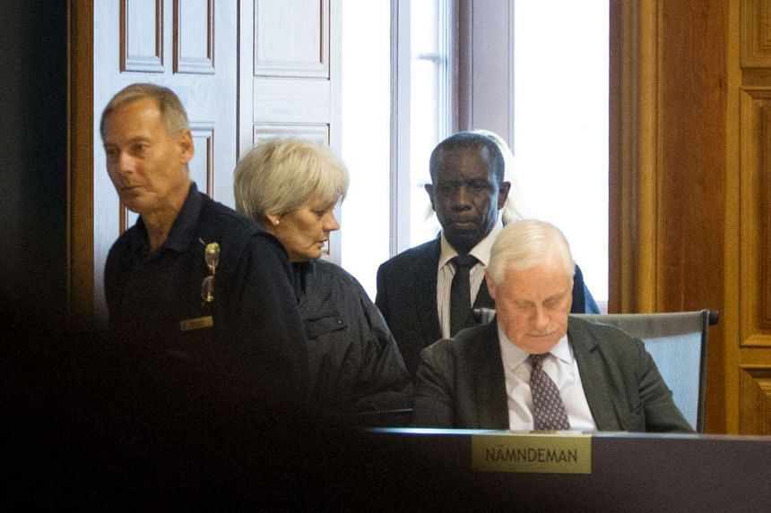 File photo of Claver Berinkindi (second from right) in court in Stockholm, Sweden, on Sept 16, 2015.