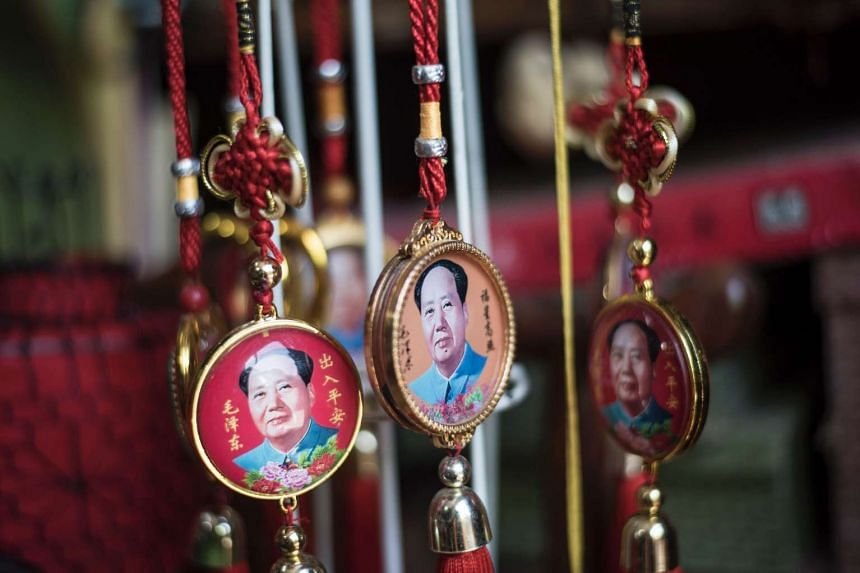 Pendants with portraits of late Chinese chairman Mao Zedong are seen for sale in a shop in Beijing on May 16, 2016.