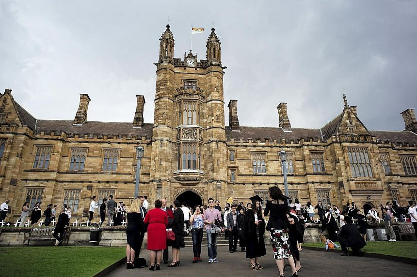 Students and their family members on the campus of the University of Sydney after a graduation ceremony. Australian government figures show that the number of Singaporeans enrolled in law, postgraduate medicine and allied health has grown.