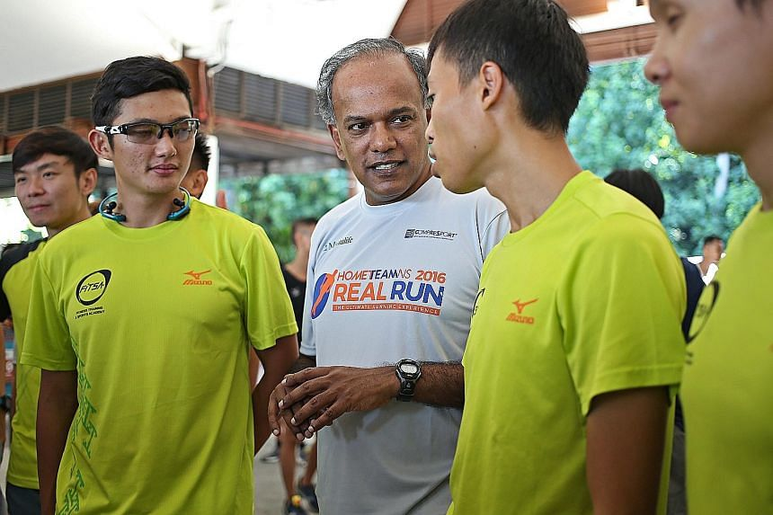 Mr Shanmugam with participants in the HomeTeamNS Real Run held on Sentosa yesterday. The minister said pilot trials related to SG Secure will begin next month in some constituencies, including his own Nee Soon GRC.