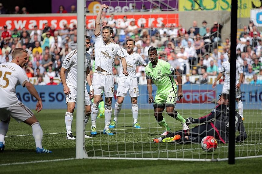 Kelechi Iheanacho putting Man City 1-0 up in their Premier League game against Swansea at the Liberty Stadium. But there was no winning end to Manuel Pellegrini's reign as the hosts equalised.