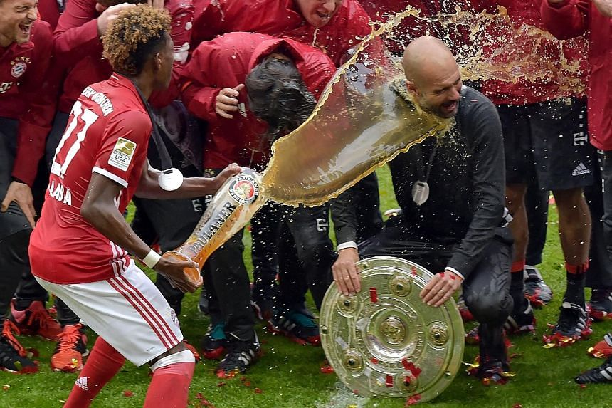 It's time for beer and cheer as coach Pep Guardiola is doused by Austrian midfielder David Alaba during Bayern's celebration of their fourth successive German Bundesliga crown. It was the Spaniard's 20th trophy as a coach and he wants to end on a hig