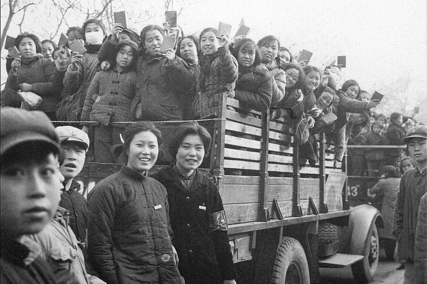 High school and university students, members of a Red Guard propaganda squad, brandishing copies of Mao Zedong's Little Red Book on the streets of Beijing during the Cultural Revolution, in this photo taken in 1966. Mr Cheng Baoluo planned to go to u