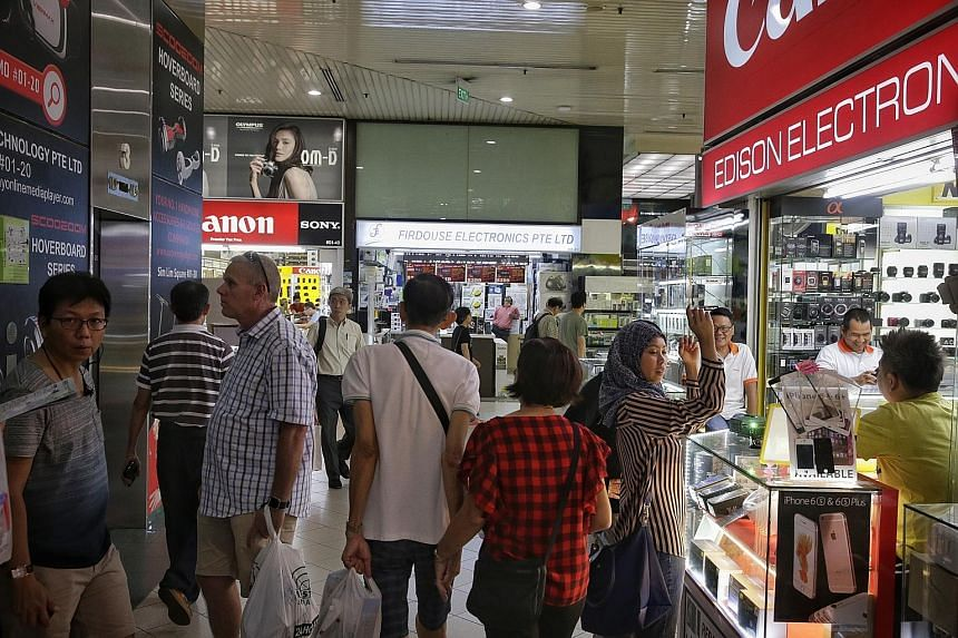 Shoppers at Sim Lim Square yesterday. The mall gained notoriety in 2014 for an incident involving a Vietnamese tourist. A shop owner there and four of his workers were later jailed for cheating.