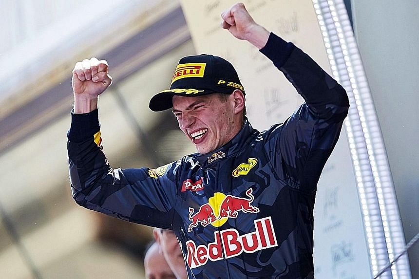 Red Bull's debutant Max Verstappen basking in the adulation of the crowd at the Catalunya circuit after winning the Spanish Grand Prix. The 18-year-old had just been promoted from Toro Rosso to replace Daniil Kvyat, who was dropped after an awful dri