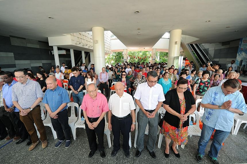 When event organiser Thye Hua Kwan Moral Society learnt that Mr Heng, who was scheduled to attend, had suffered a stroke, it decided not to invite another guest of honour to replace him. Yesterday, guests at the event (above) joined a silent prayer f