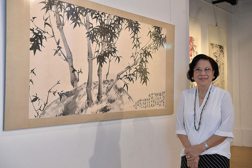 Painter Fan Chang Tien's daughter, Mrs Teresa Yao (left), is showing 60 of the artist's paintings.