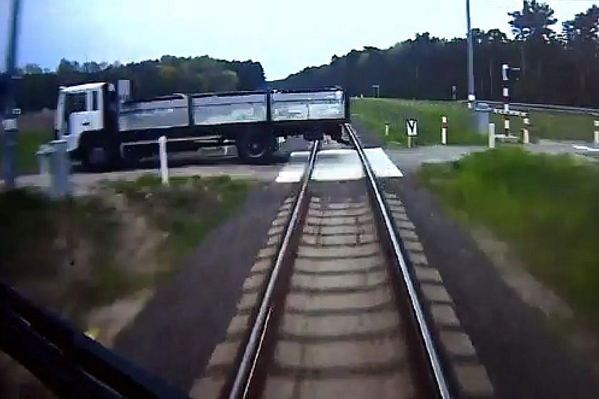 Mr Szymanski spotted a lorry stuck on the train track, directly in the path of the train. CCTV footage showed him sprinting through a carriage to warn passengers. The footage also showed him crouched on the ground, bracing himself for impact. The tra