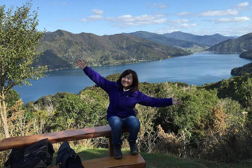 Ms Jo'di Koh packing peaches in Hawke's Bay on North Island. Through her jobs in New Zealand, she learnt more about differences in working attitudes across cultures. Ms Laurentia Yong at the Queen Charlotte Track in Picton. Taking on various odd jobs