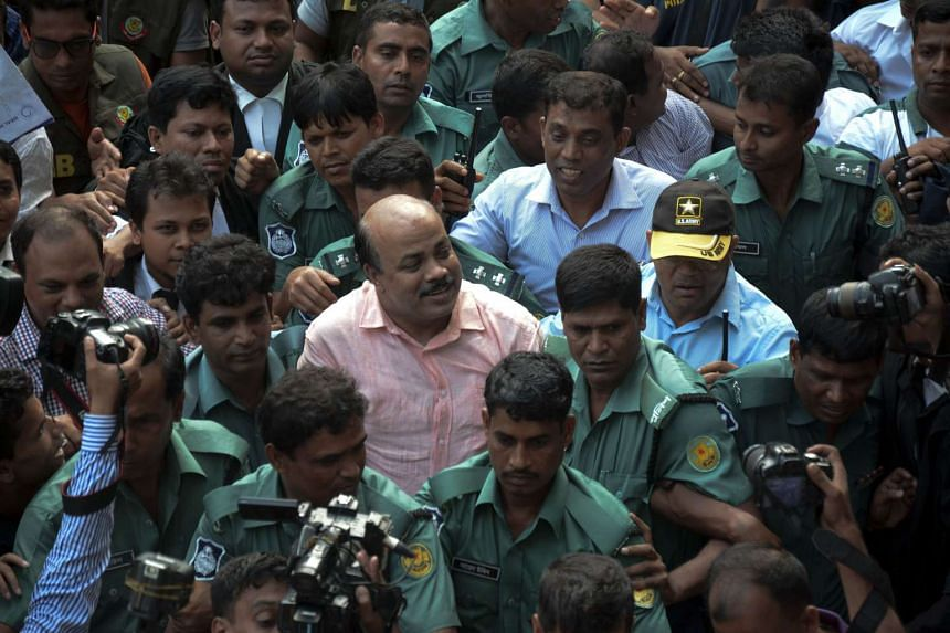 Bangladeshi security personnel escort Bangladesh Nationalist Party (BNP) joint secretary general Aslam Chowdhury (centre) towards court following his arrest in Dhaka, on May 16, 2016.