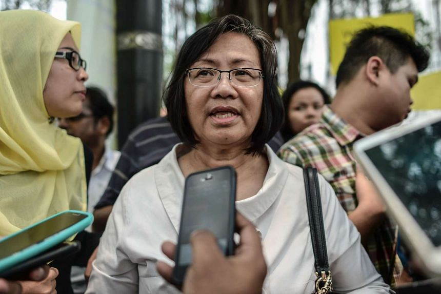 This file photograph taken on Sept 2, 2015 shows chairperson of Bersih, Maria Chin Abdullah (centre) smiling as she speaks to journalists.