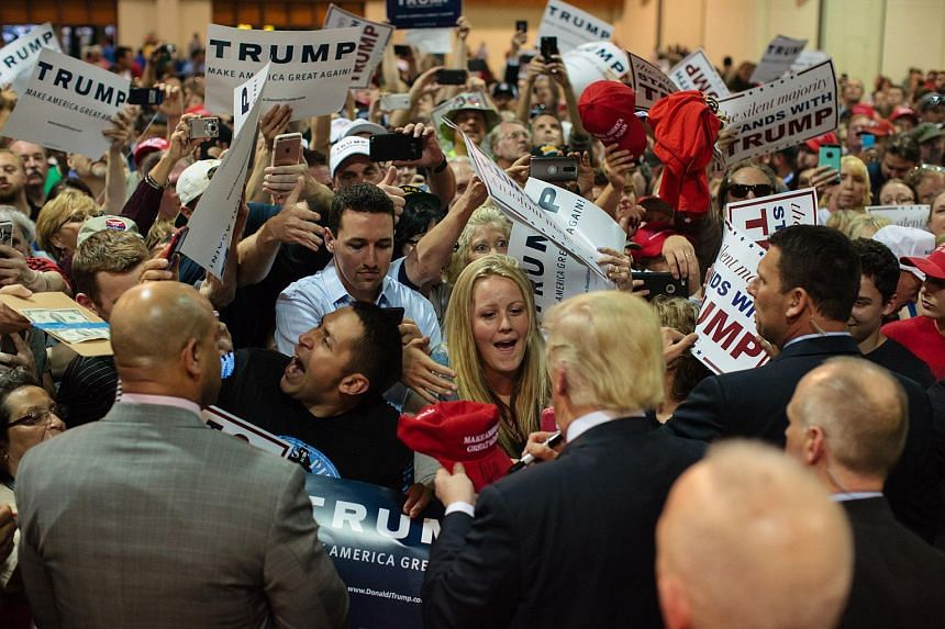 US Republican presidential candidate Donald Trump greeting supporters during a rally in Eugene, Oregon on May 6, 2016.