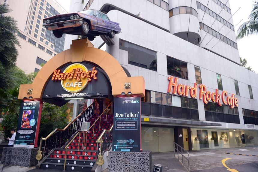 The facade of the Hard Rock Cafe along Cuscaden Road, with the iconic Cadillac over the top of the entrance.