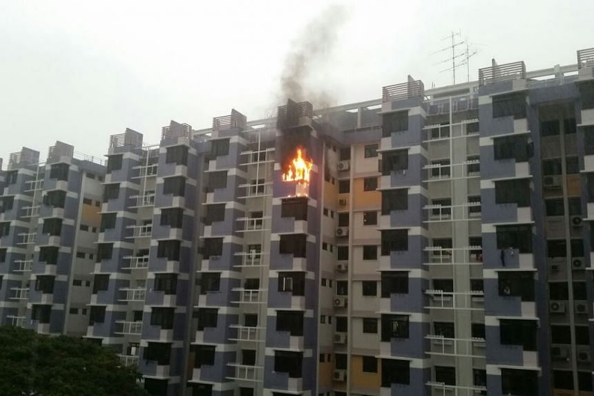A flat unit in Block 117, Bedok North Road, which caught fire on May 16, 2016.
