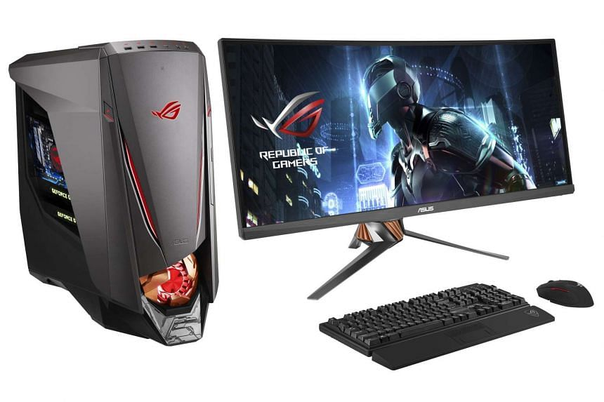 The $7,498 Asus ROG GT51CA gaming PC (pictured with the 34-inch ultrawide monitor).
