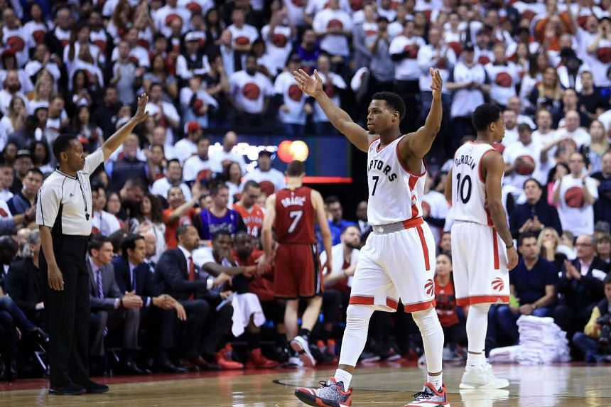 Kyle Lowry #7 of the Toronto Raptors celebrates late in the second half of Game Seven of the Eastern Conference Quarterfinals against the Miami Heat during the 2016 NBA Playoffs.