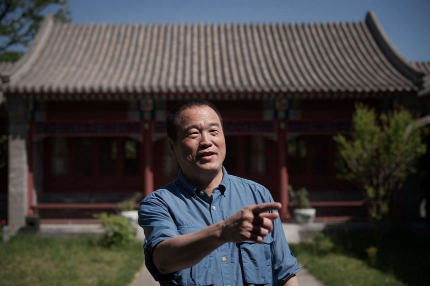 Chinese poet and billionaire Huang Nubo gesturing at the Chinese Poetry Research Institute, inside the Pekin University in Beijing.