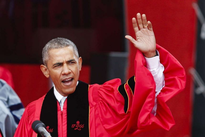 Barack Obama waves to the crowd during the 250th anniversary commencement ceremony at Rutgers University on May 15, 2016.