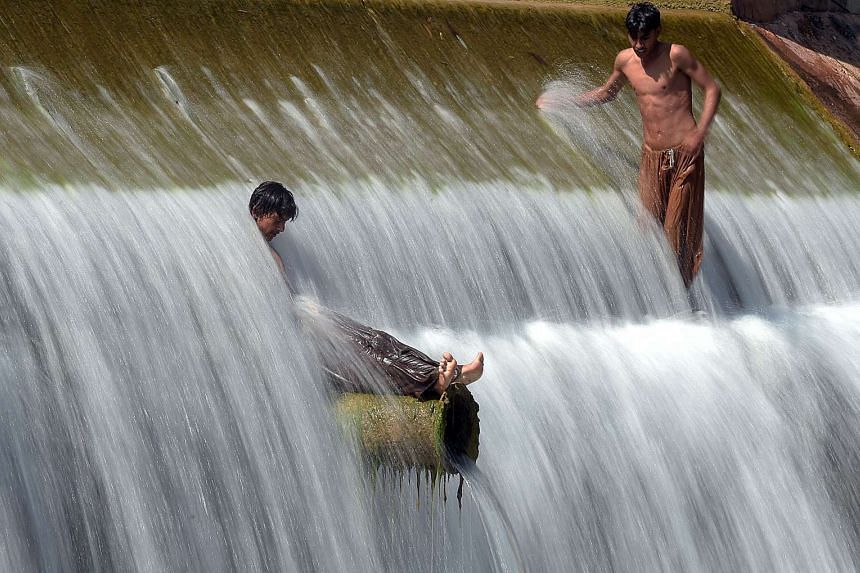Pakistani youths cool off in a stream during hot weather on the outskirts of Islamabad in April, which Nasa says is the warmest April on record.
